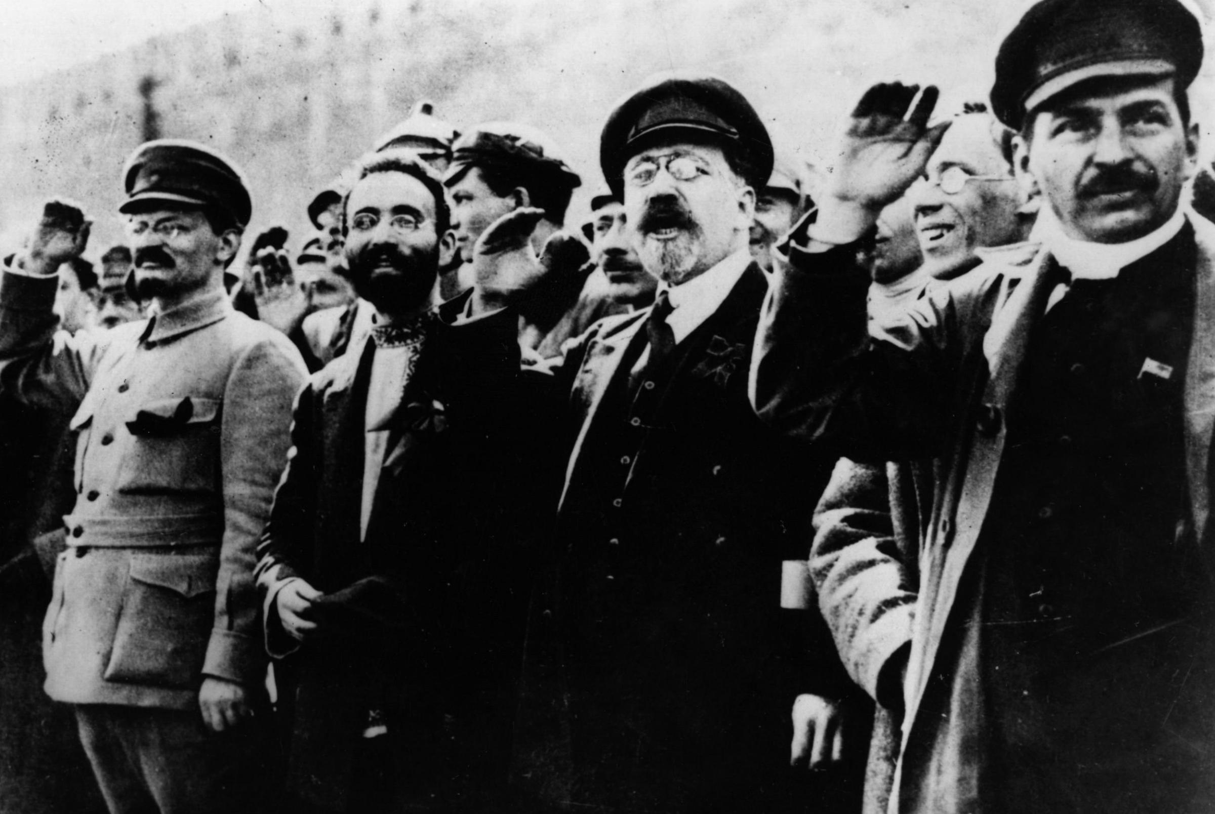 Stalin and Trotsky salute in the street during the Russian Revolution