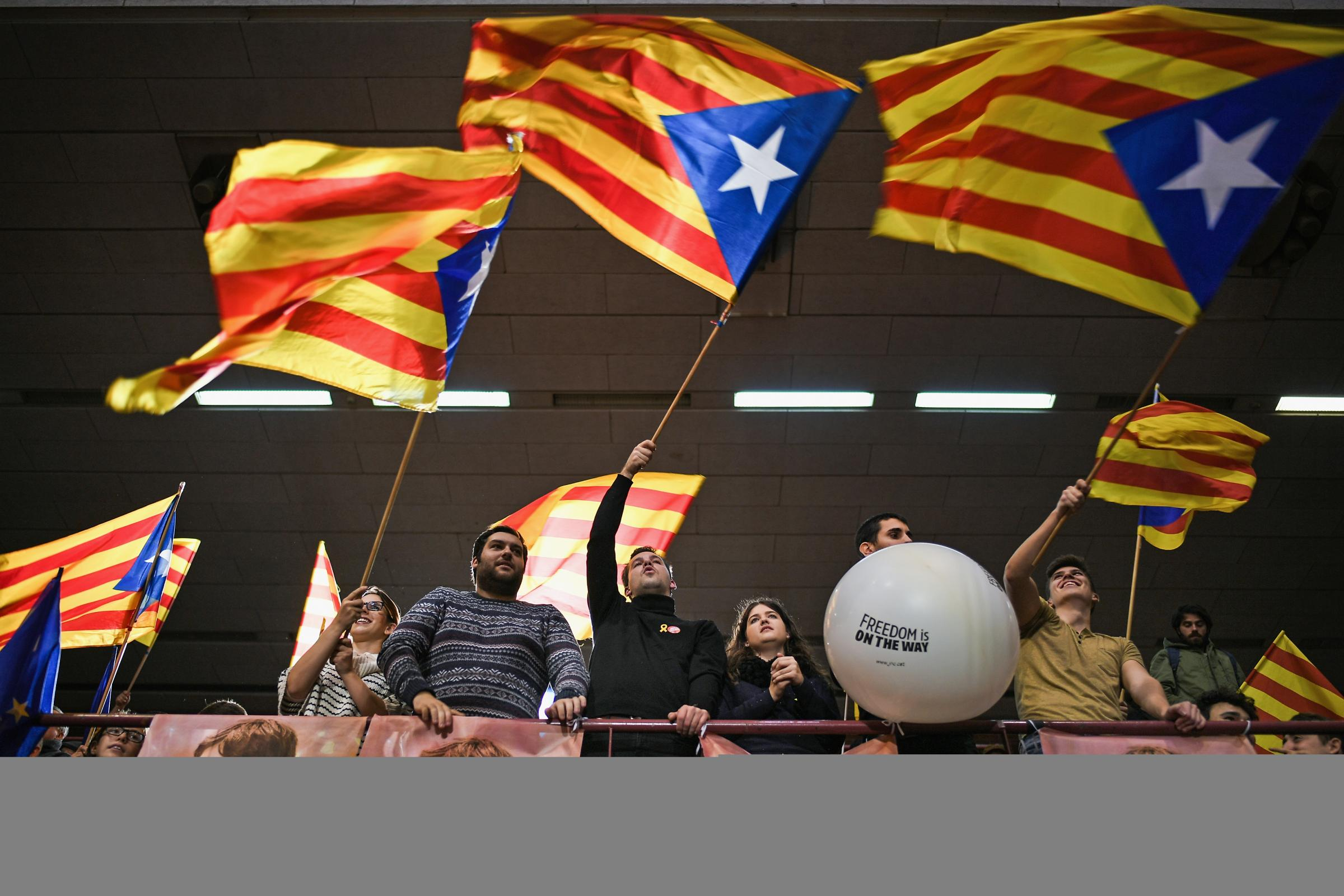 Junts Per Catalunya party activists at a rally for the forthcoming Catalan election. Photograph: Jeff J Mitchell