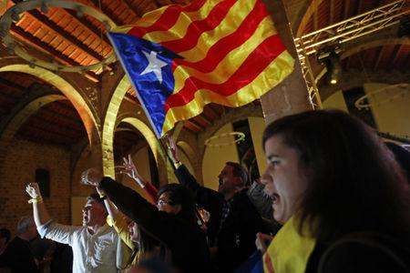 The National: Catalan independence supporters wave a 'estelada' ( pro-independence Catalan flag ) celebrate at the ANC ( Catalan National Assembly ) headquarters after results of the regional elections in Barcelona, Spain, Thursday, Dec. 21, 2017. The pro-seces