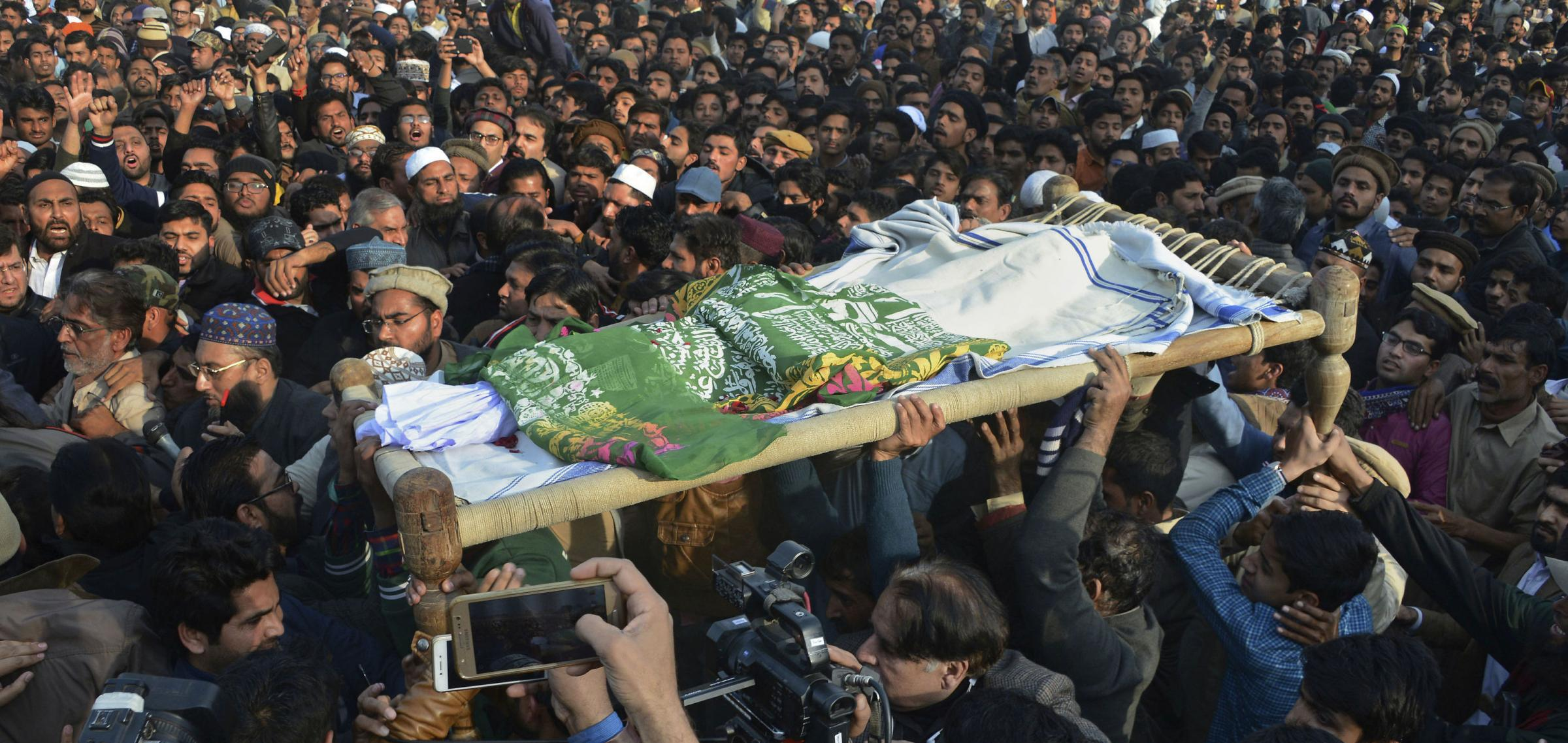 Crowds lined the streets to mourn the loss of Zainab Ansari before bloody protests began. Photograph: AP