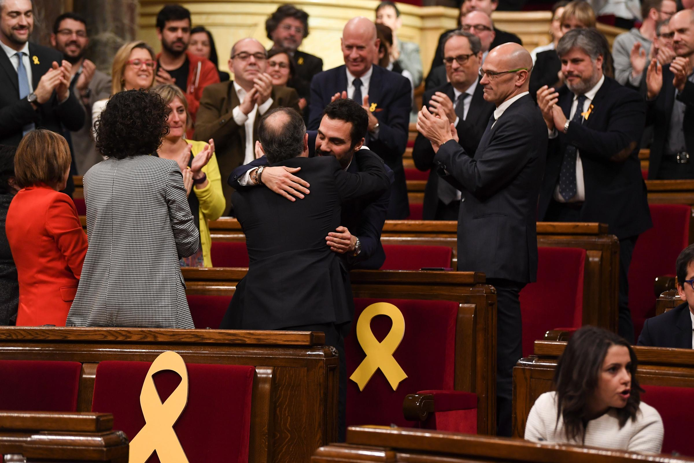 The new President of the Catalan Parliament, Roger Torrent, centre, was congratuled on his election