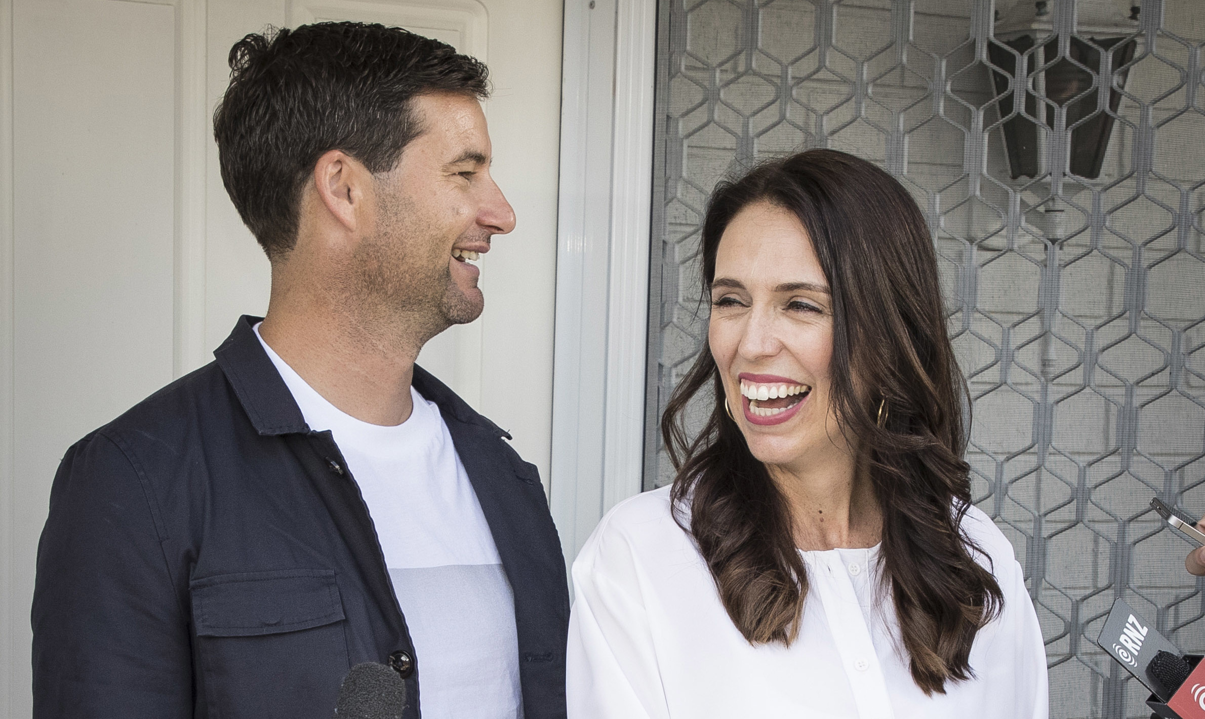 New Zealand Prime Minister Jacinda Ardern, right, and her partner Clarke Gayford