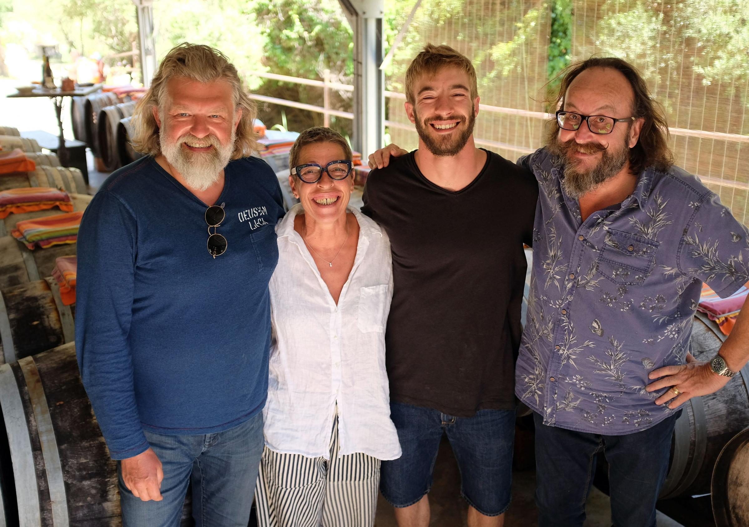 Hiary Bikers Si King, left, and Dave Myers, right, meet vinegar producers Nathalie Lefort and her son Adrien