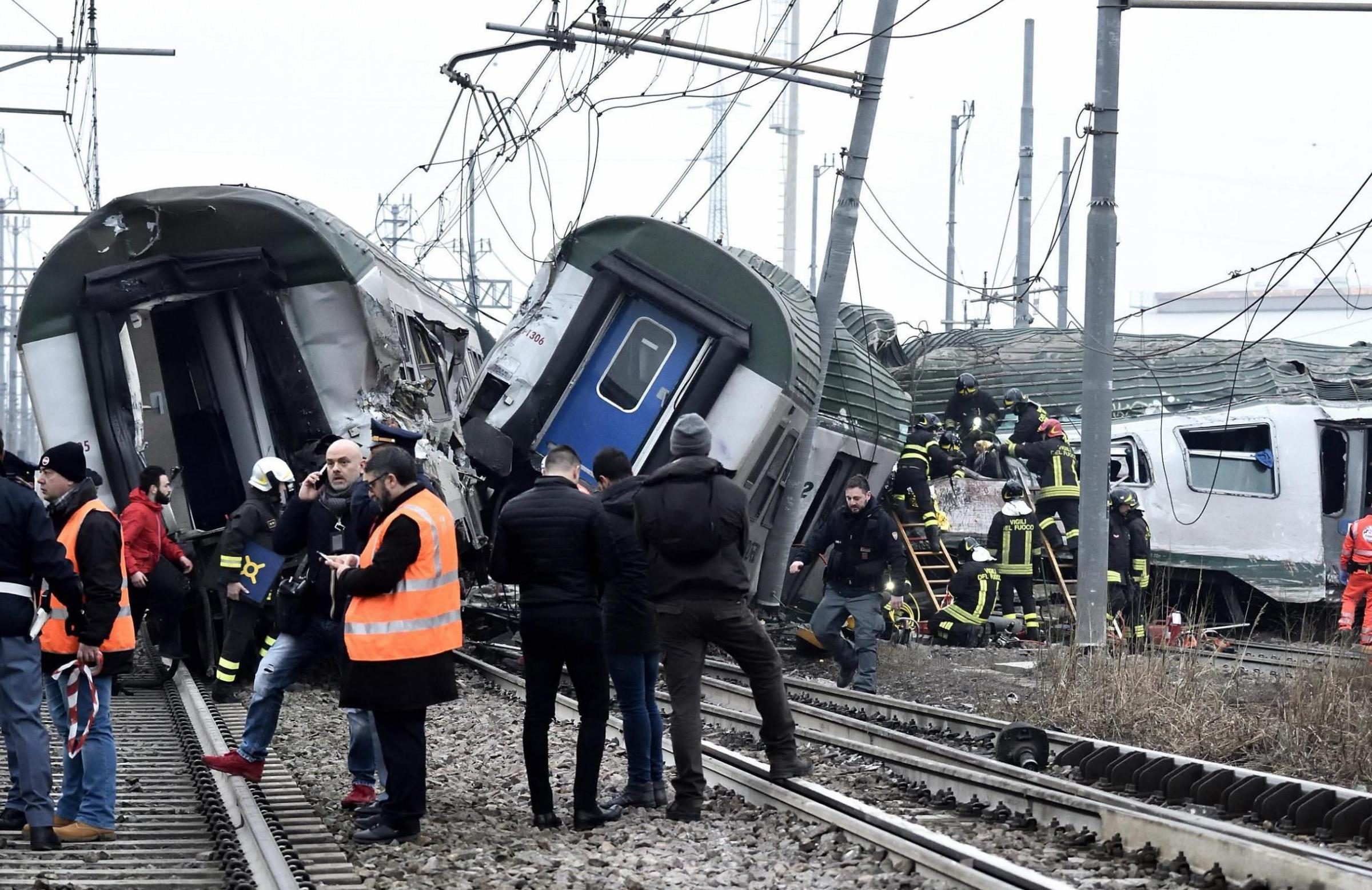 Rescue teams help passenger out of a derailed train at the station of Pioltello Limito, on the outskirts of Milan, Italy, Thursday, Jan. 25, 2018