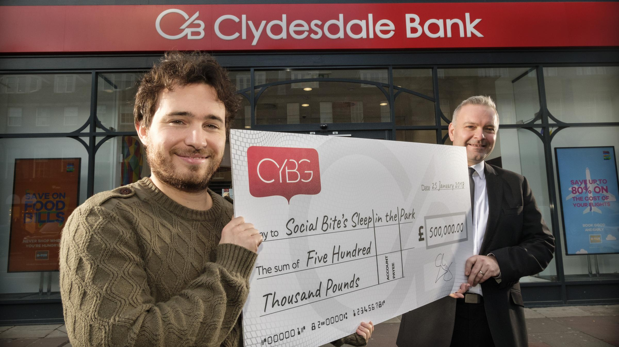 Gerry Magee of CYBG presented the cheque to Social Bite's Josh Littlejohn (left)