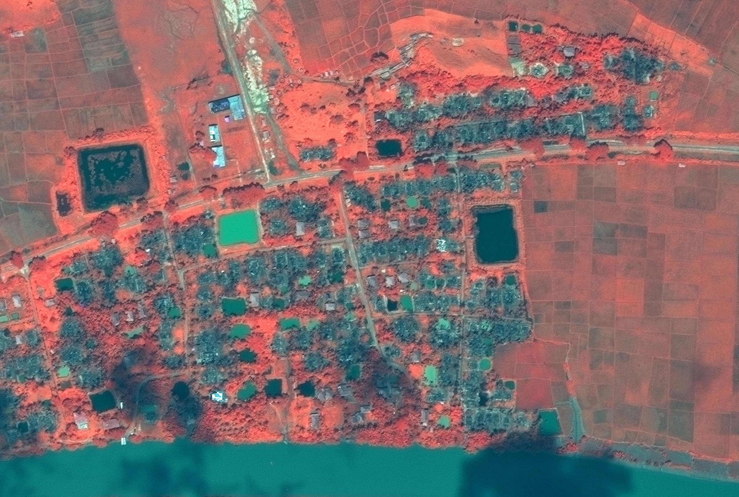 Satellite images and mobile phone footage (below) verify the existence of more mass graves. Photograph: AP