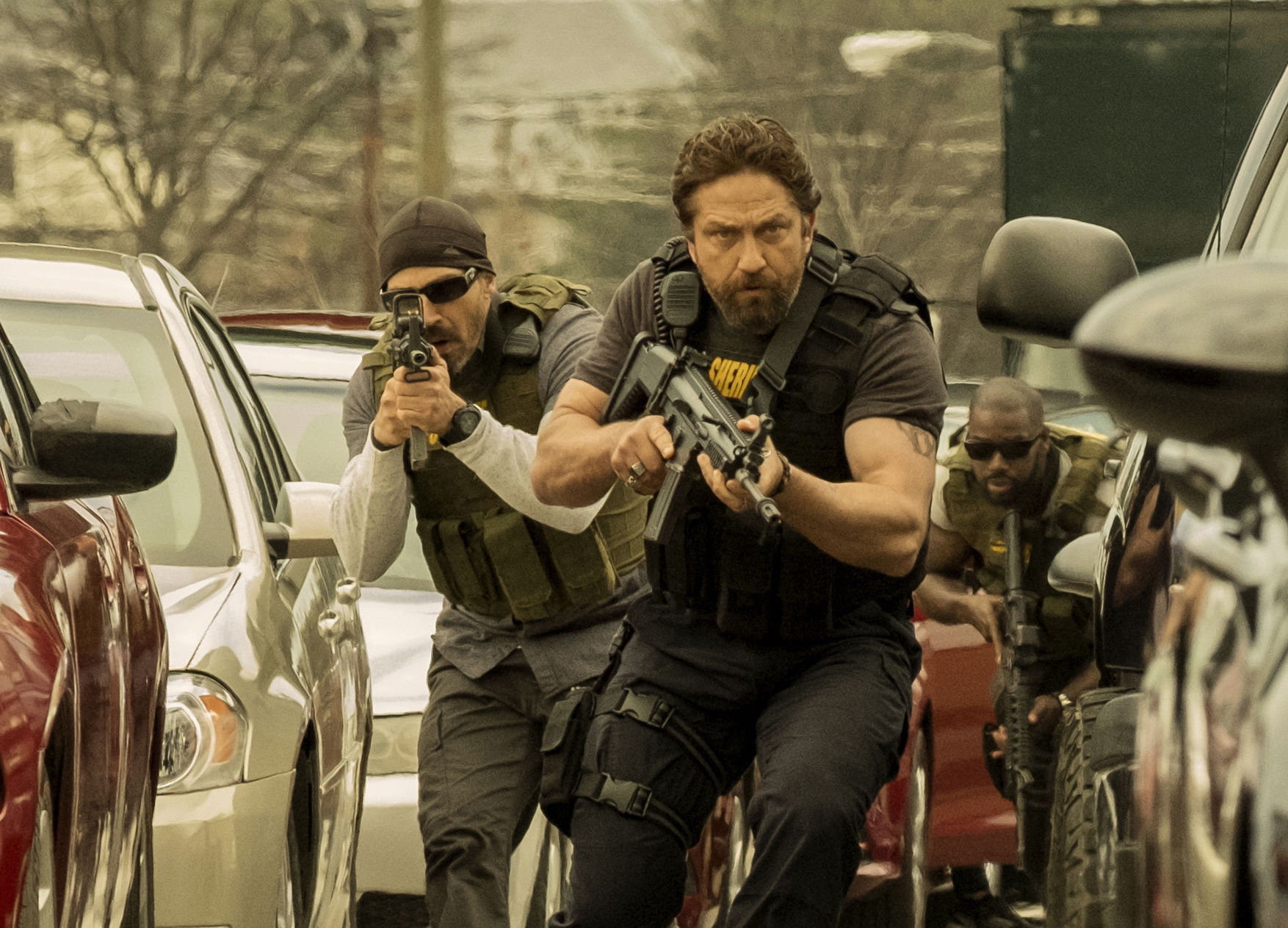 Jay Dobyns as Wolfgang and Gerard Butler as Detective Nick O'Brien