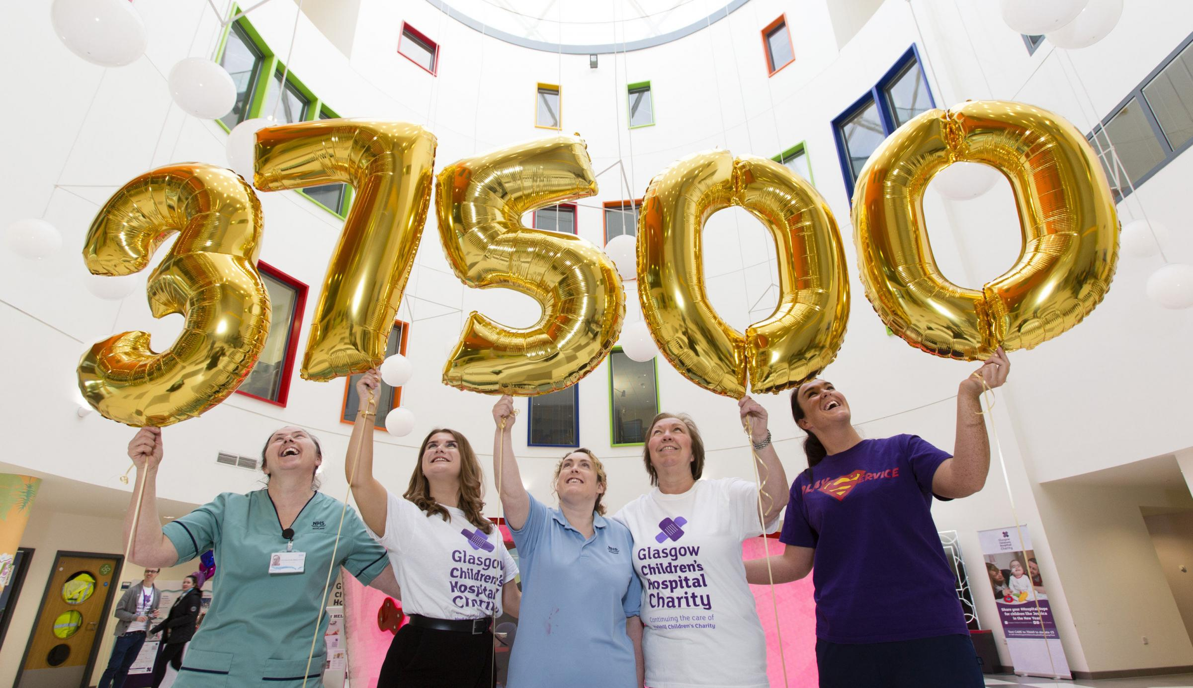 Buchanan Galleries and Glasgow Children's Hospital Charity staff celebrate the shopping centre raising £37,500 in 2017