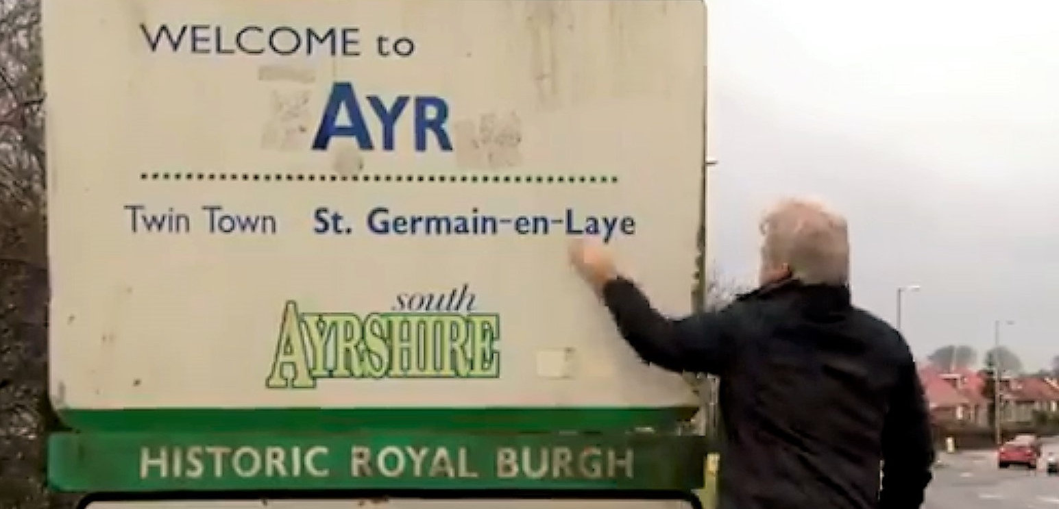 Taking a shammy to the Ayr road sign is a key part of an MP's functions in the broadcast