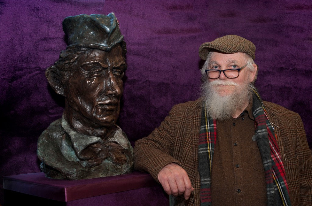 Sculptor Frank Casey at the unveiling of a bronze bust of John McIntosh
