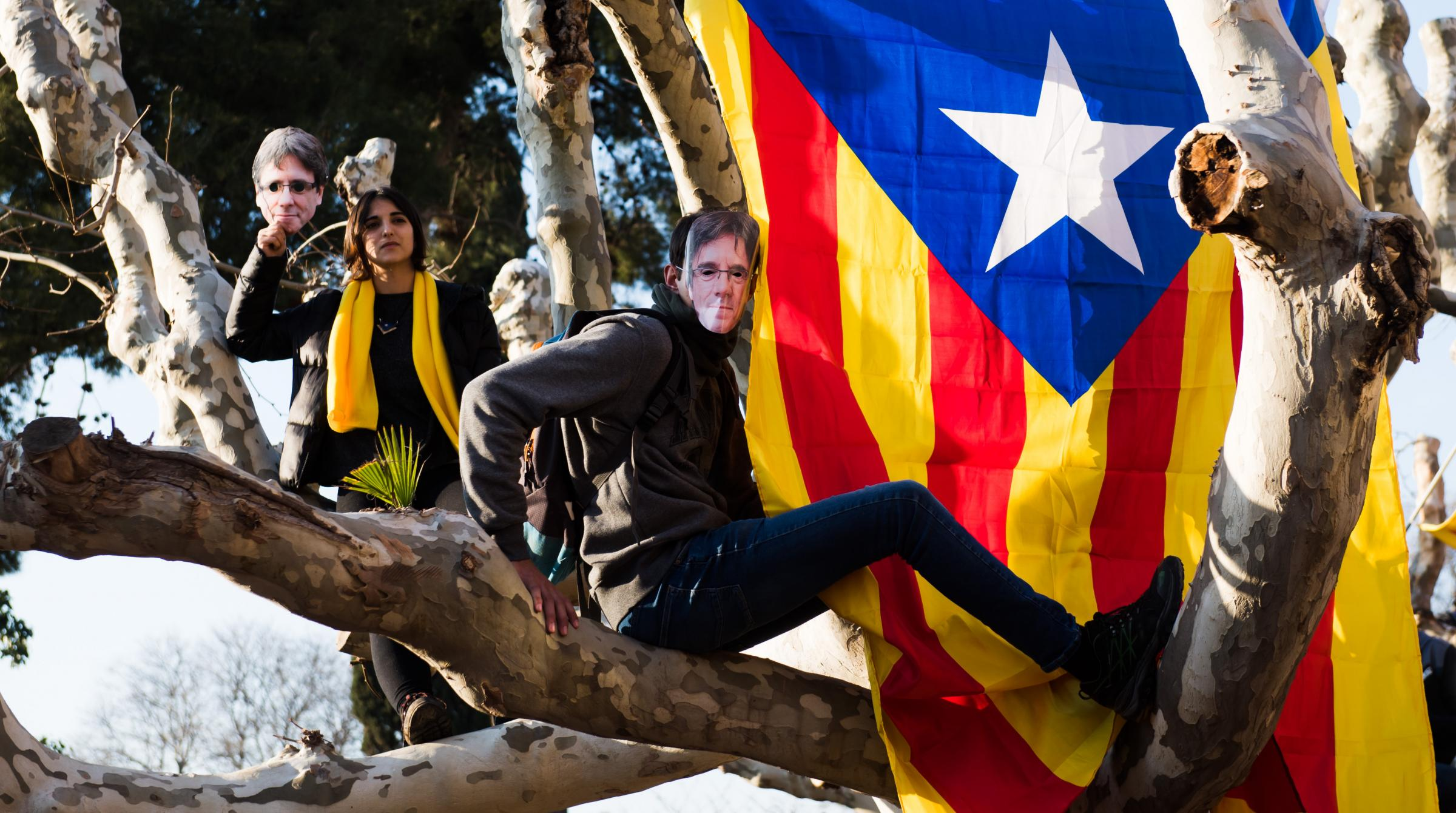 Demonstrators wore cut-out masks of Puigdemont as they protested in front of the Parliament of Catalonia on January 30 in Barcelona
