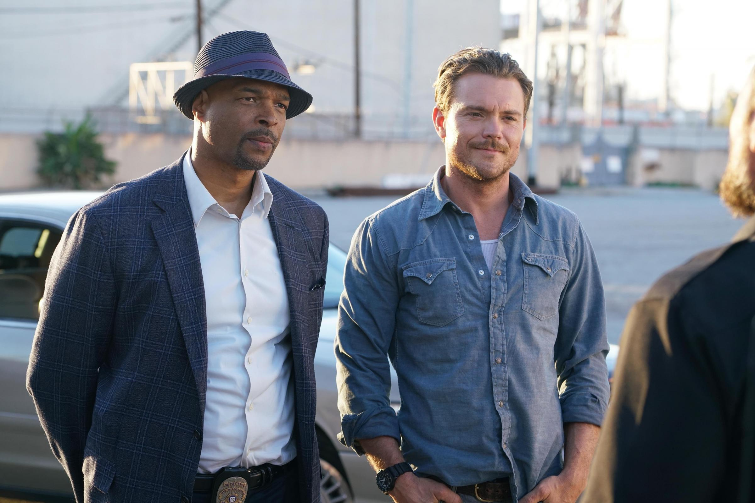 Murtaugh, left, and Riggs investigate the death of a surfer in Lethal Weapon