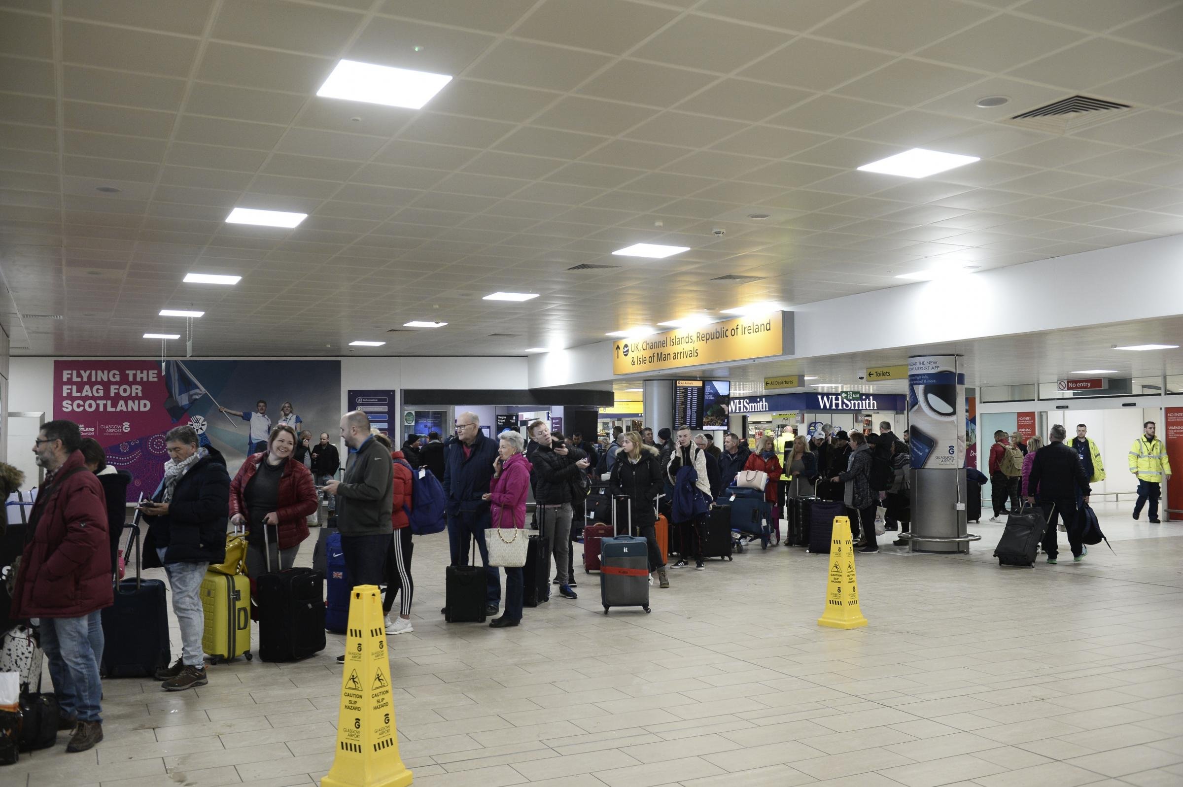 Passengers at Glasgow Airport were forced to queue for taxis yesterday as the snow saw flights cancelled. Photograph: Jamie Simpson