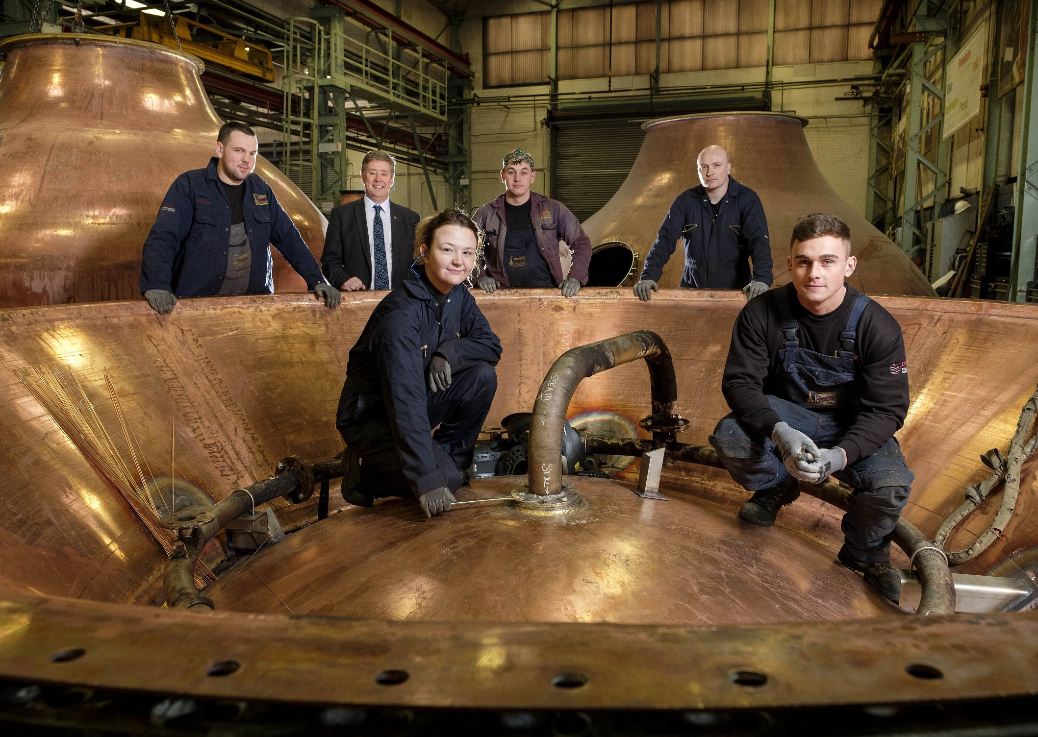 From left: apprentices Scott Roberson, Rebecca Weir, James Watt, Steven Key, Jack Docherty and Keith Brown (second left)