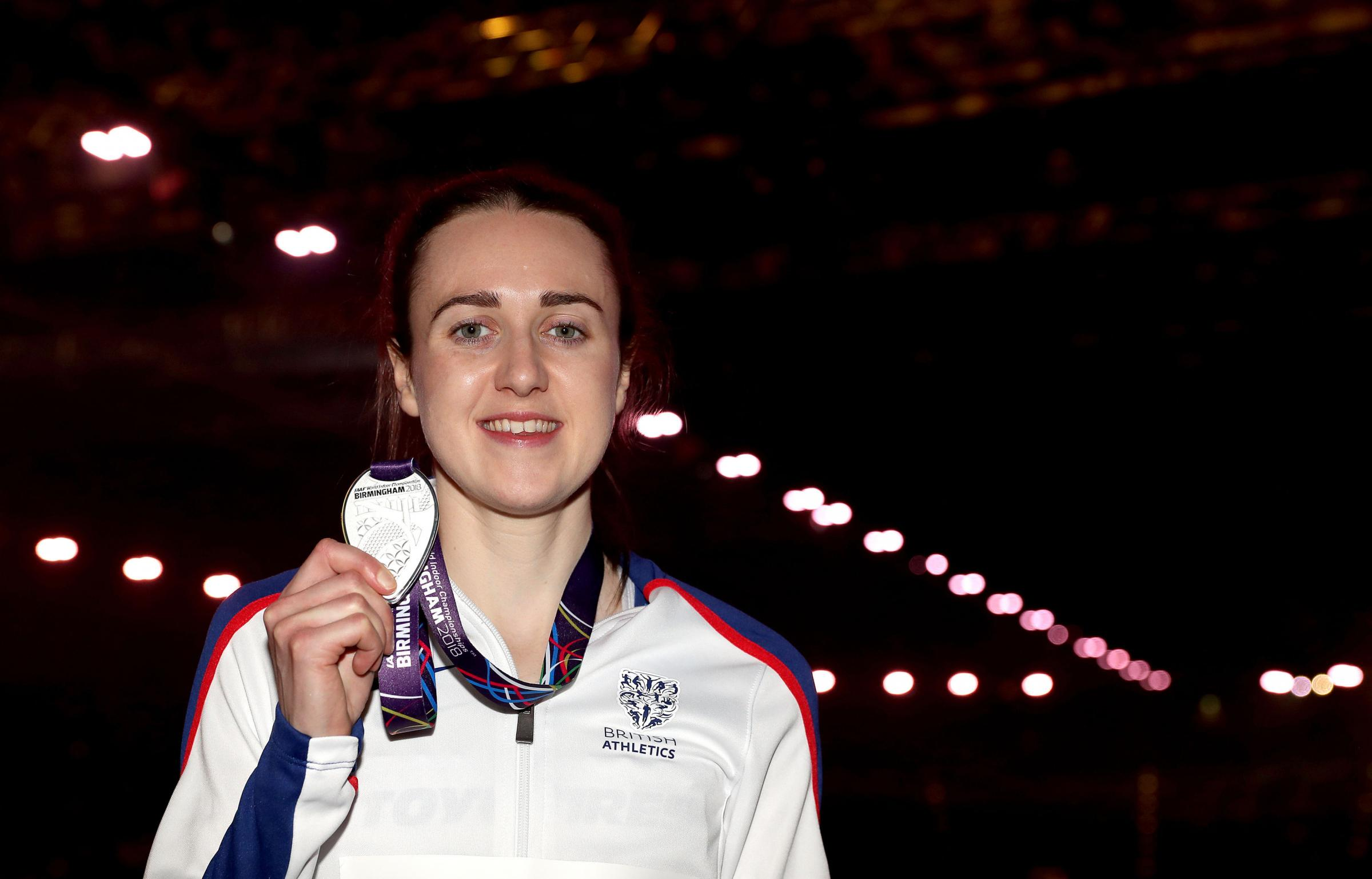 Great Britain's Laura Muir celebrates with her silver medal in the 1500m during day three of the 2018 IAAF Indoor World Championships at The Arena Birmingham. PRESS ASSOCIATION Photo. Picture date: Saturday March 3, 2018. See PA story ATHLETICS Birmin
