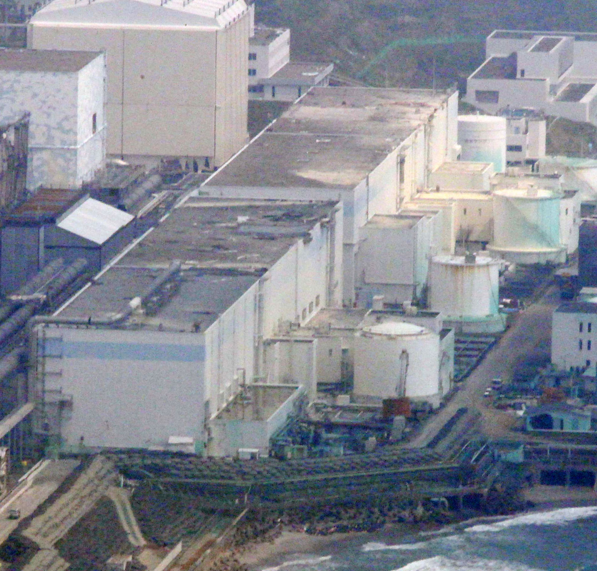 FILE - In this May 28, 2012 aerial file photo, reactors of the tsunami-stricken Fukushima Dai-ichi nuclear power plant stand in Okuma, Fukushima Prefecture, northeastern Japan. An underwater robot on Wednesday, July 19, 2017, captured images and other dat
