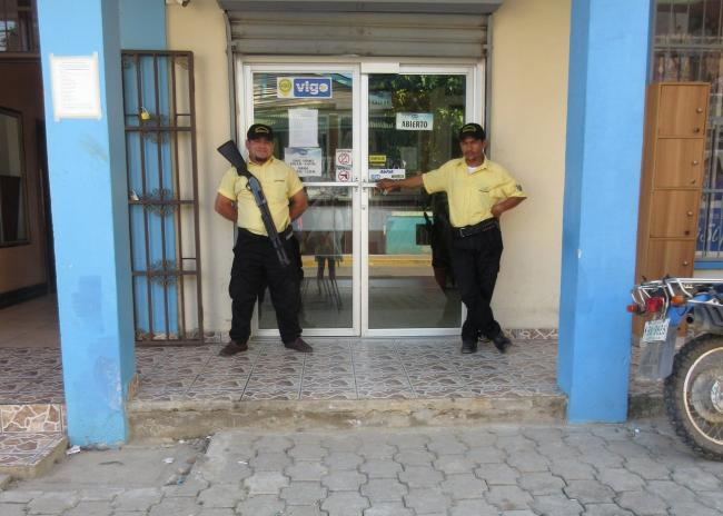 Armed guards outside a Western Union office in Honduras, which has one of the highest homicide rates in the world