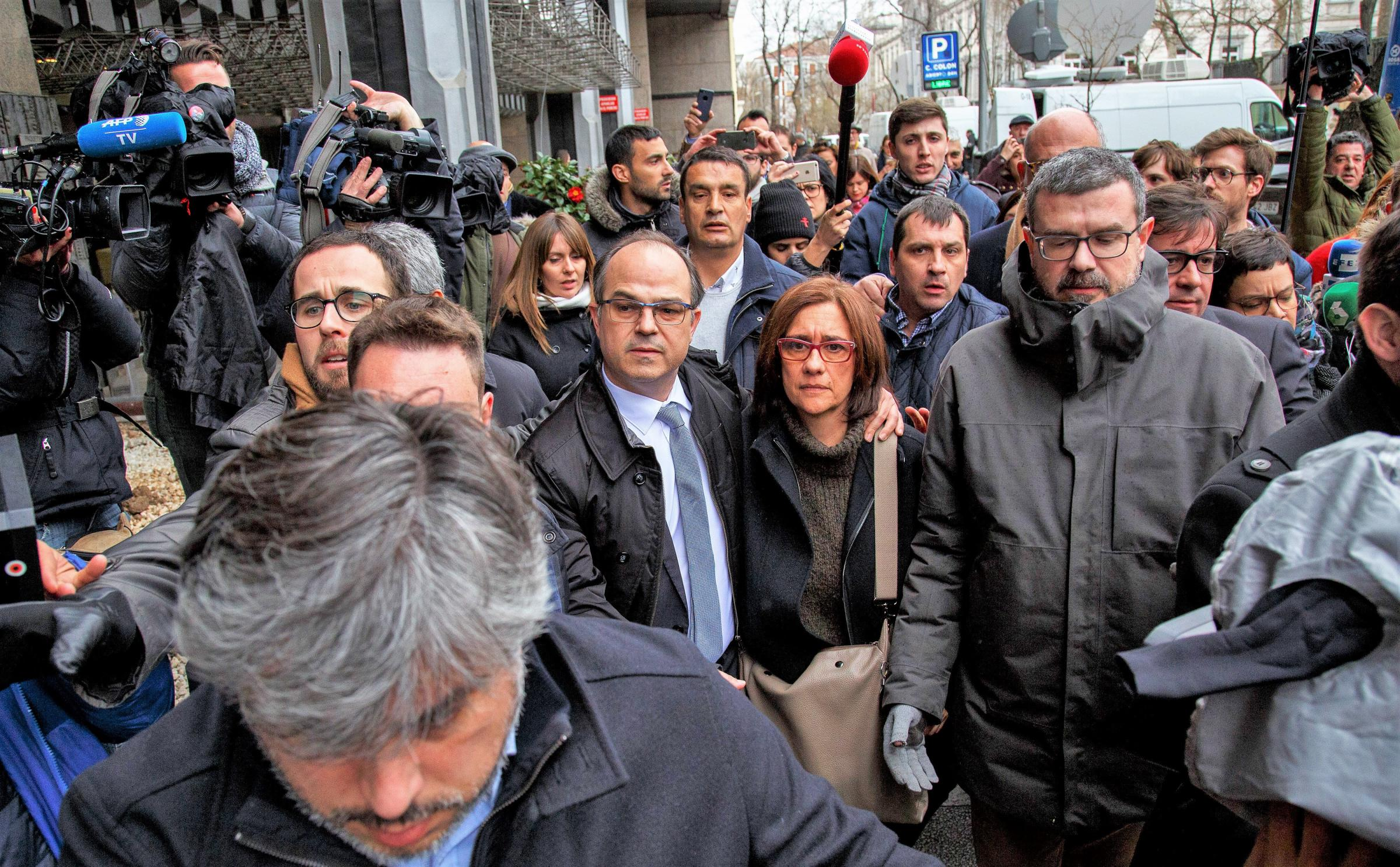 Catalan politician Jordi Turull, centre, will be detained without bail