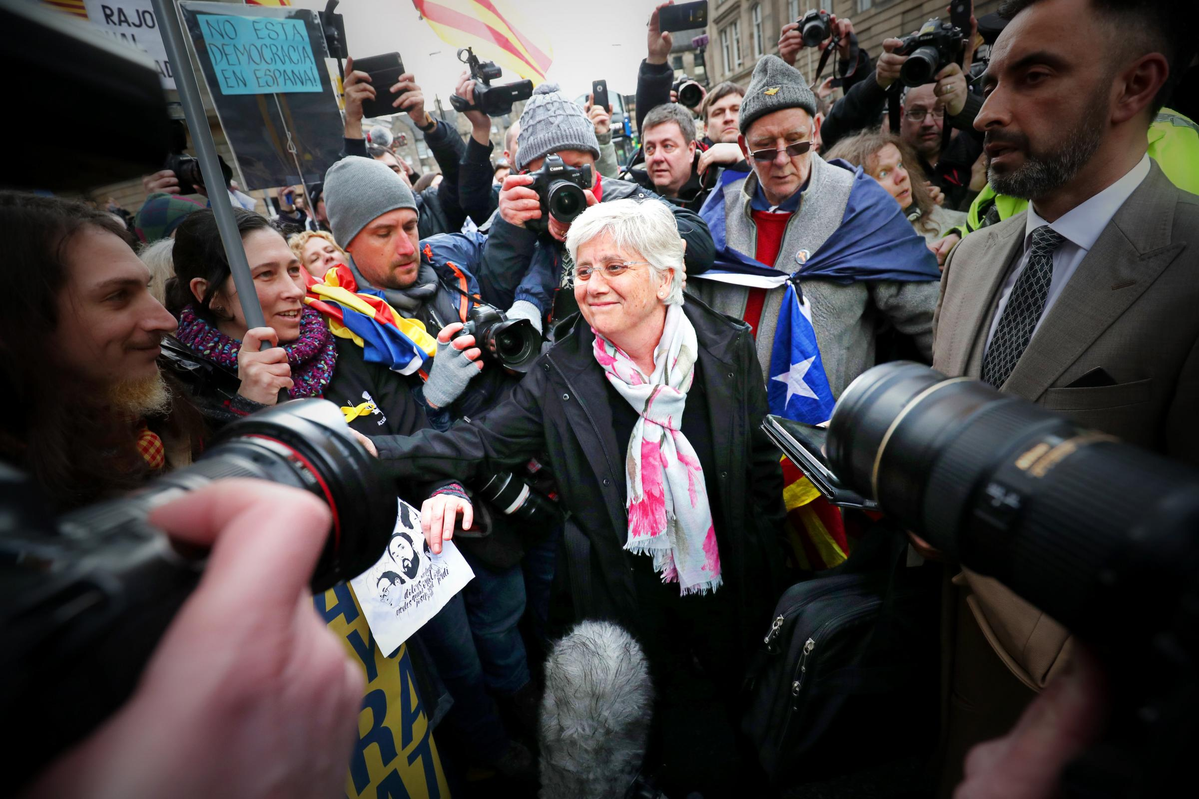 Former Catalan education minister Clara Ponsati greets supporters alongside her lawyer Aamer Anwar outside Edinburgh Sheriff Court. Photograph: PA