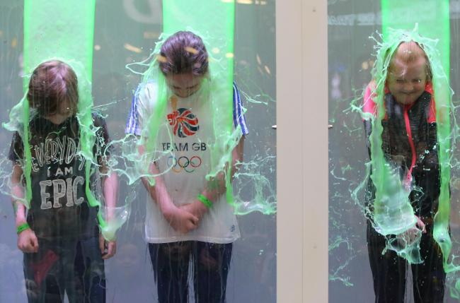 From left: Cooper Smith age 9, his sister Freya age 11 from Clydebank and Hayden Hendry age 10 from Uddingston get slimed