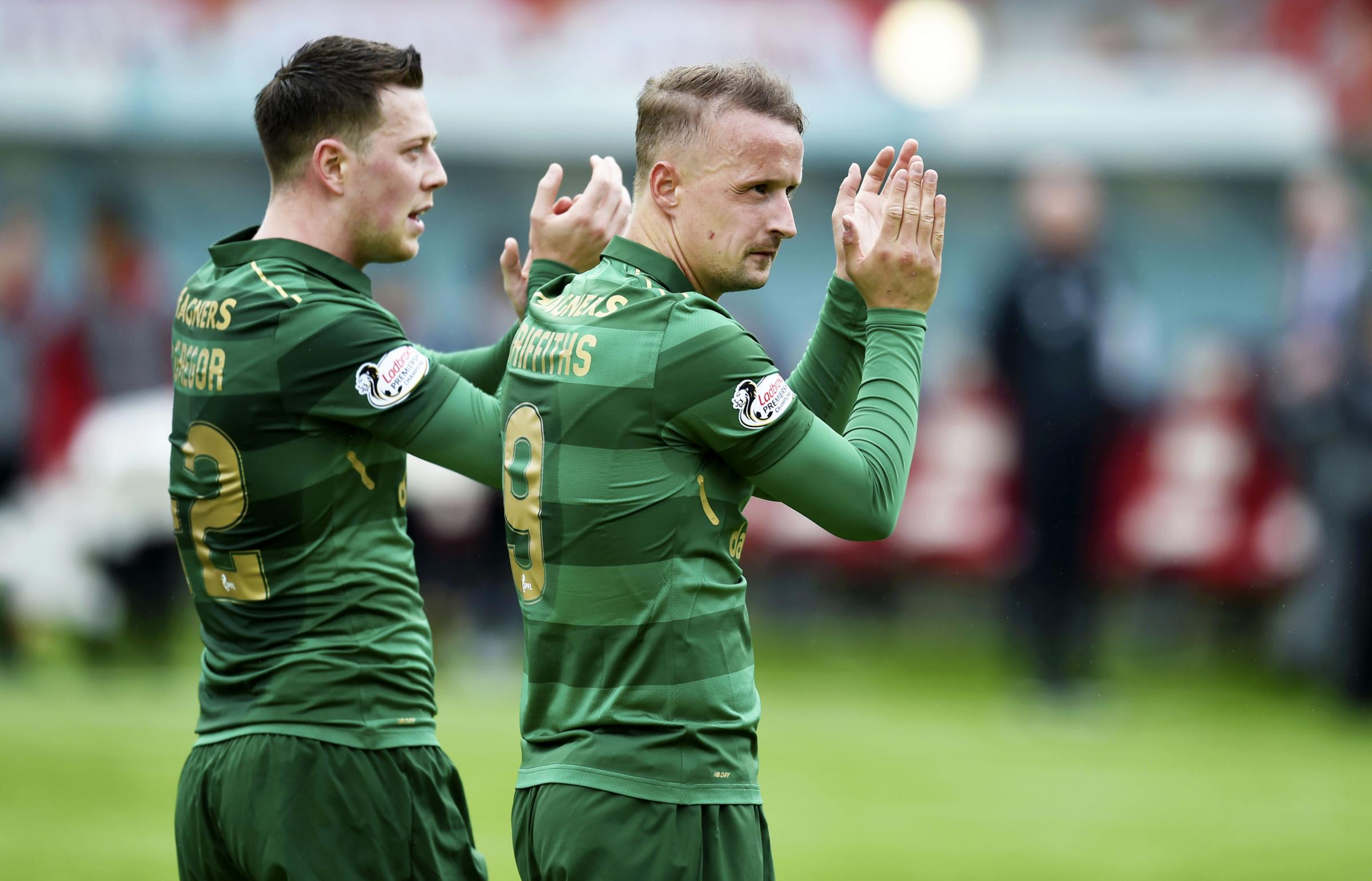 Celtic goalscorers Leigh Griffiths, right, and Callum McGregor, left, celebrate at the end of the 2-1 win over Hamilton yesterday.