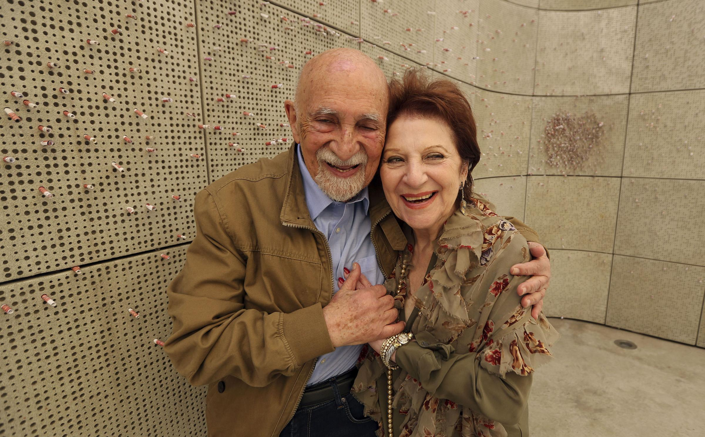 Holocaust survivors Simon Gronowski and Alice Gerstel Weit hug at the Los Angeles Holocaust Museum memorial. Photograph: AP
