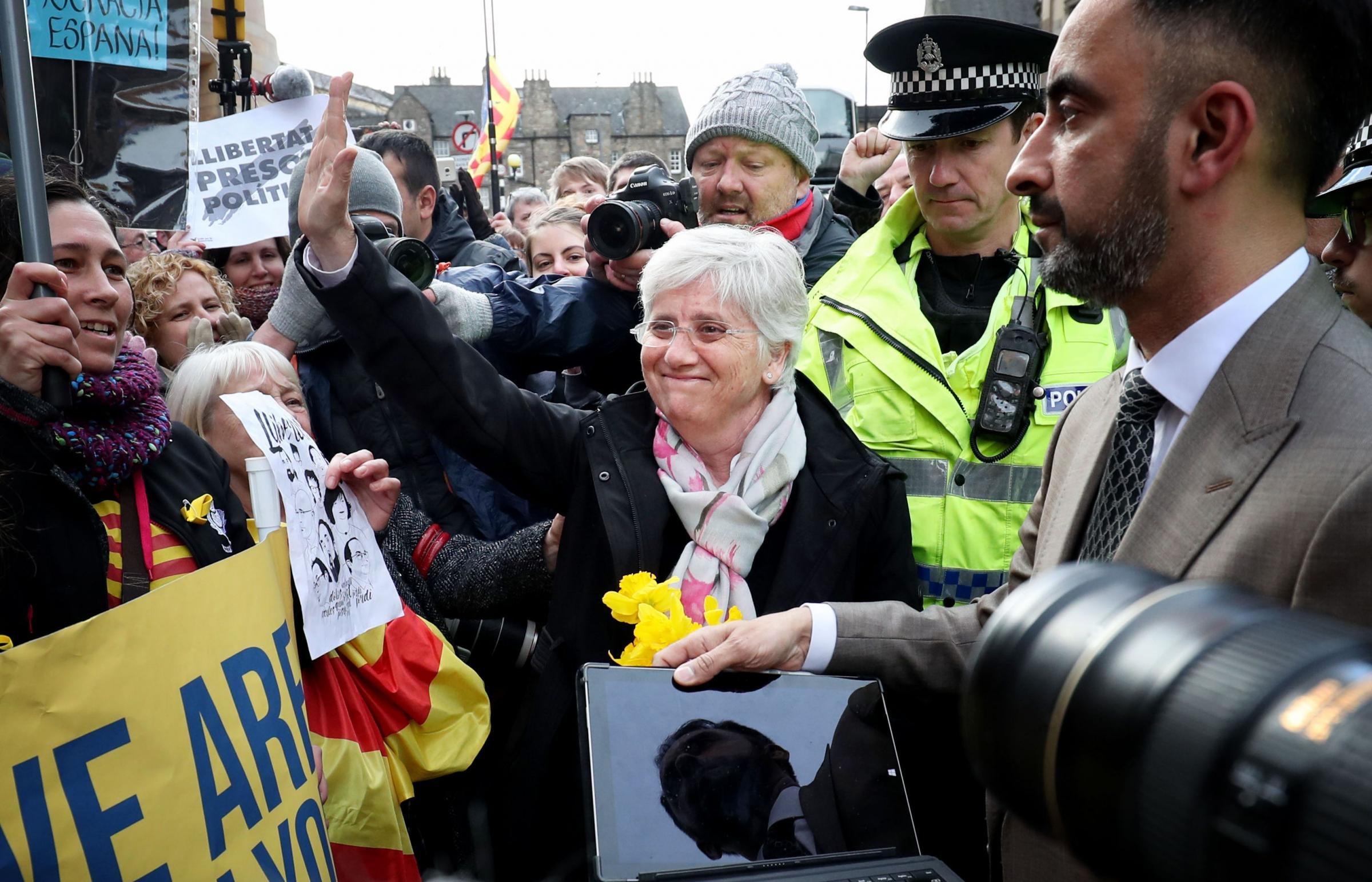 Former Catalan education minister Clara Ponsati (centre), who is facing extradition to Spain, greets supporters alongside her lawyer Aamer Anwar outside Edinburgh Sheriff Court after she was released on bail in March