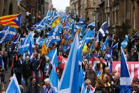 The National: Tens of thousands of independence supporters took to the streets of Glasgow for the AUOB march. Photograph: Gordon Terris
