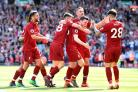 Andy Robertson of Liverpool celebrates with his team mates after scoring his side's fourth goal against Brighton and Hove Albion at Anfield on Sunday.