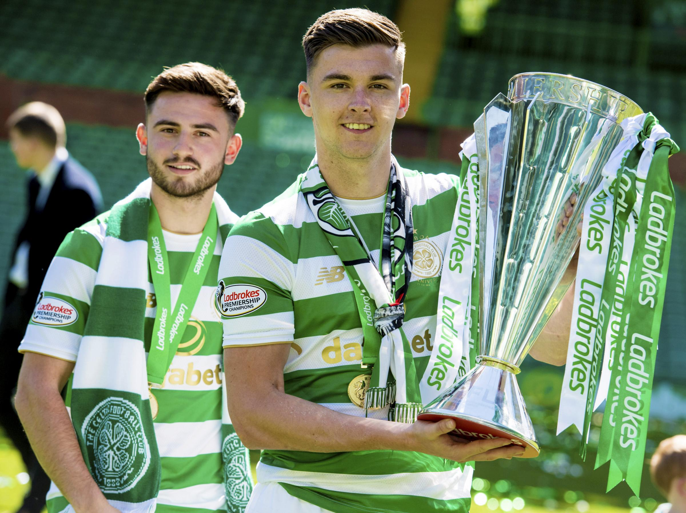 Celtic left back Kieran Tierney celebrates with the Ladbrokes Premiership trophy with team mate Patrick Roberts.
