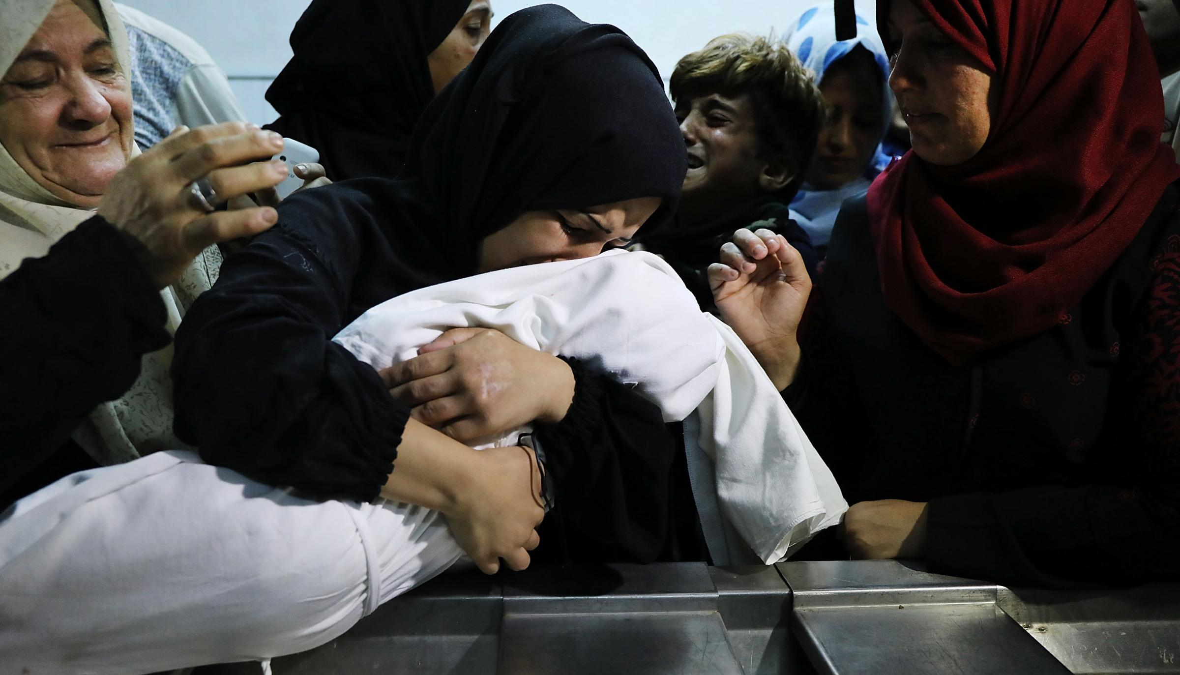 The mother of eight-month-old Leila Anwar Ghandoor, who died in the hospital yesterday morning from tear gas inhalation, hugs her daughter a last time as she is prepared for burial. Photograph: Getty