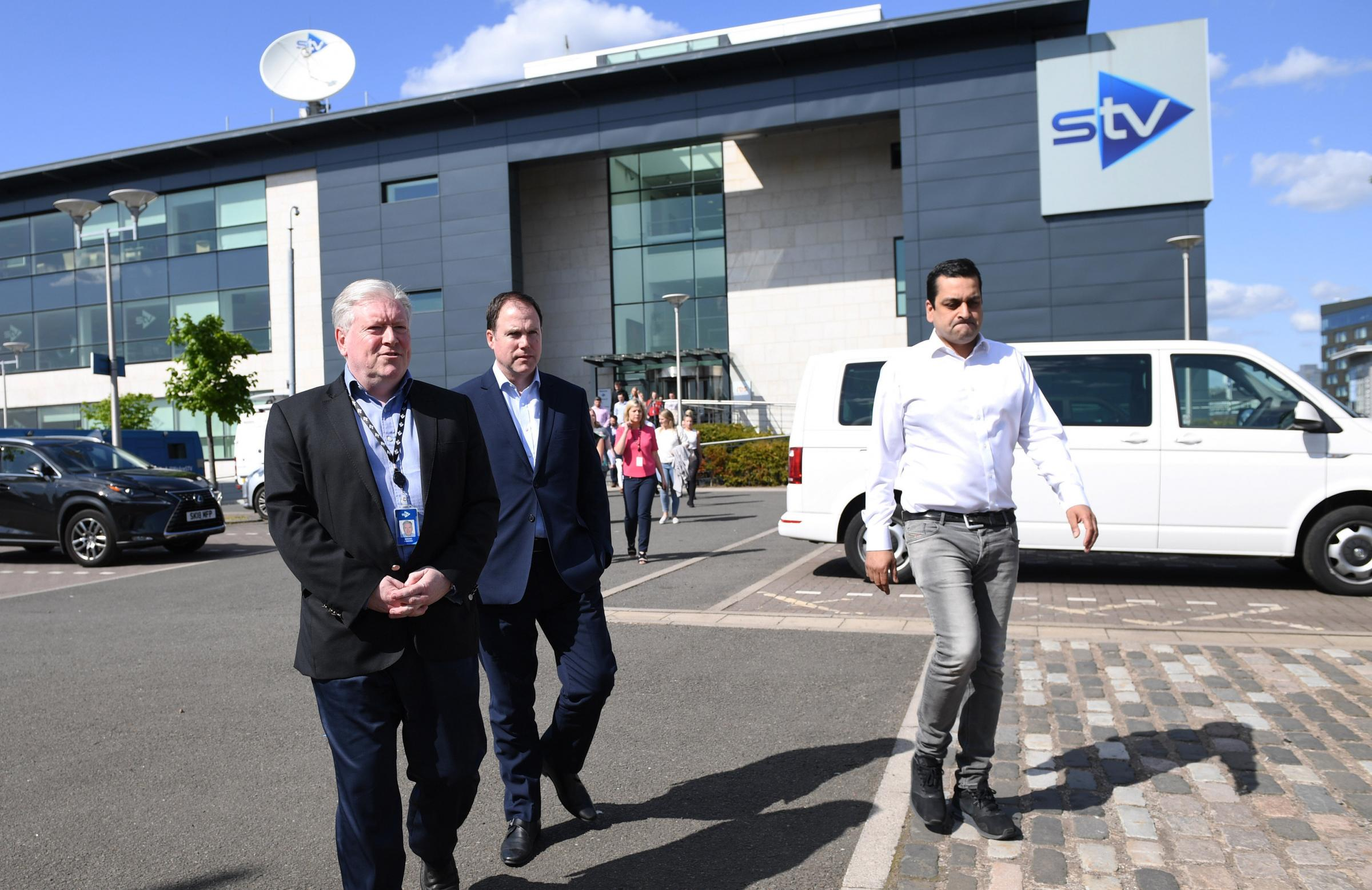 Staff at STV including, from left, Bernard Ponsonby, John MacKay and Raman Bhardwaj walked out after it was announced dozens of jobs would be axed