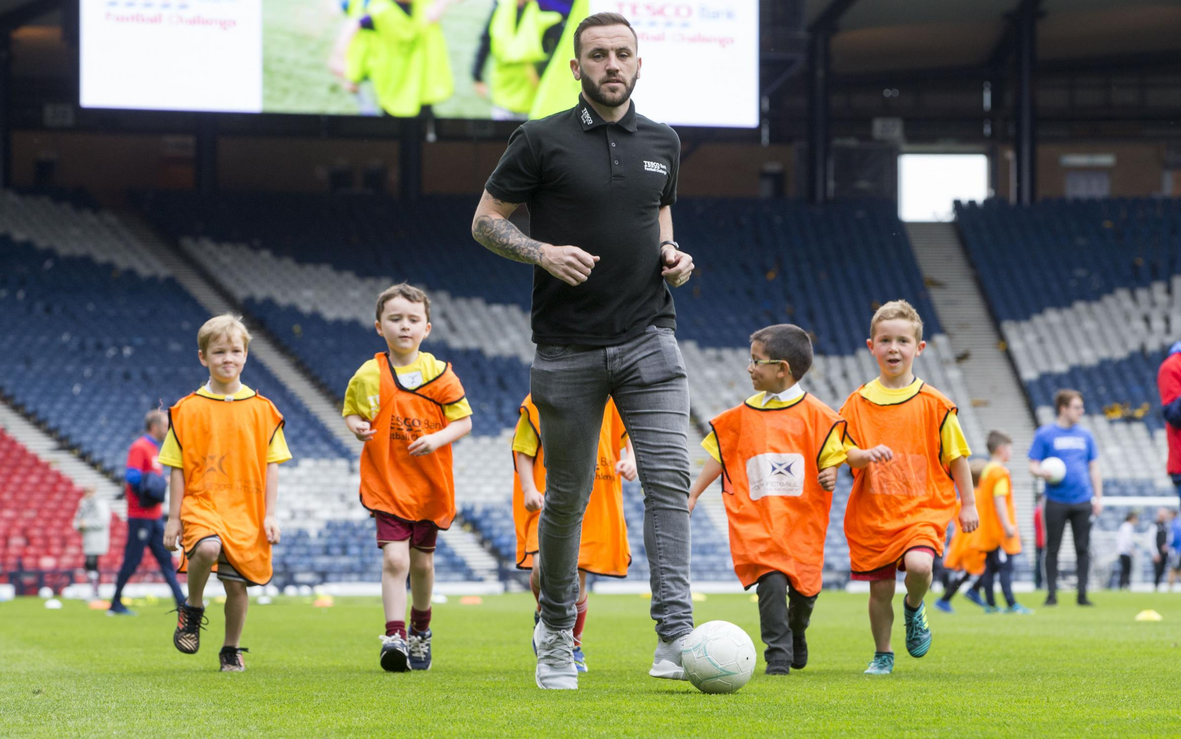 Scotland coach James McFadden showed some schoolkids how to play during the Tesco Bank Football Challenge National Festival at Hampden yesterday.