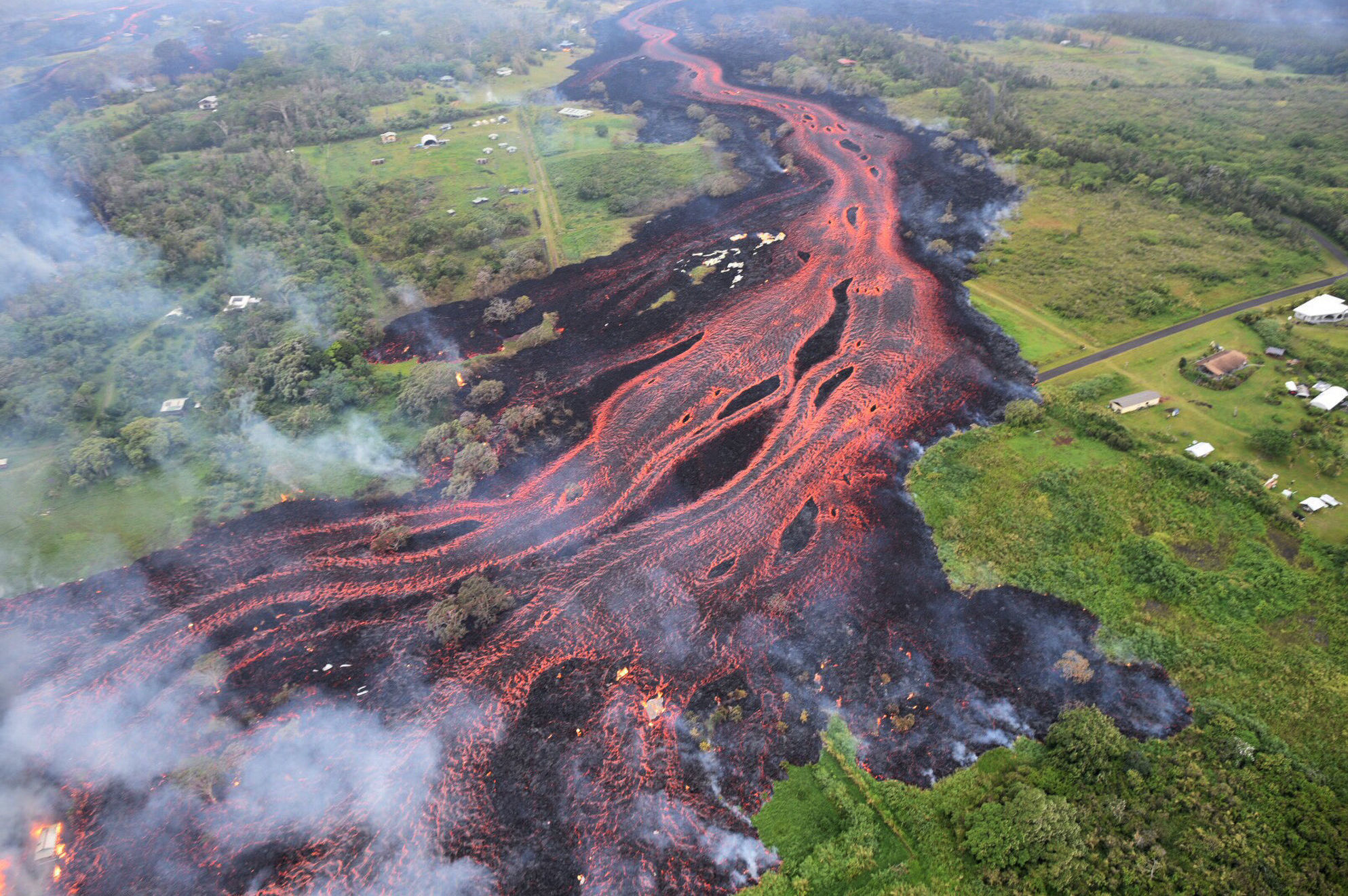 Lava flows from fissures near Pahoa, Hawaii. Kilauea volcano began erupting more than two weeks ago and has burned dozens of homes