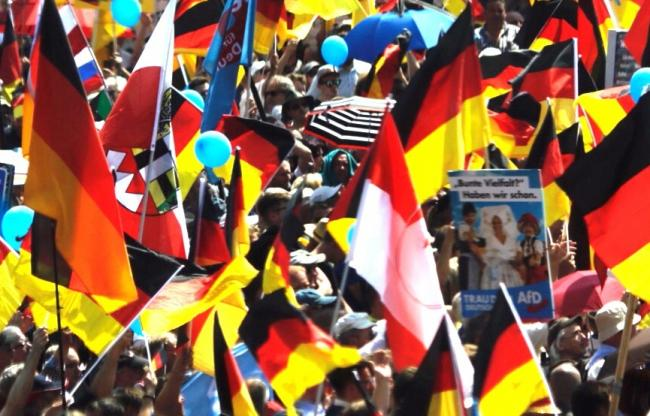 German March against Merkel's government leads to counter