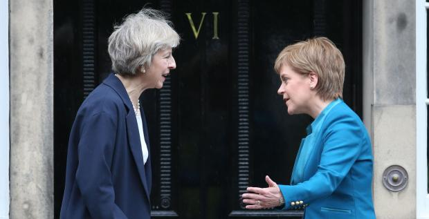 The National: Sturgeon needs to remind May that her permission is not required for Scotland to have an indyref2