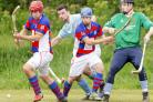 Caberfeidh's Blair Morrison and keeper Ewan Pilcher battle to keep Kingussie pair Rory McGregor and James Falconer at bay