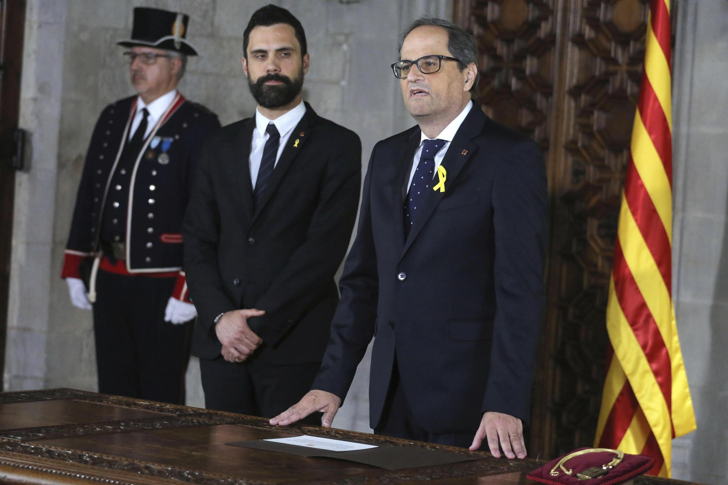 Catalan president Quim Torra, right, next to Catalan Parliament speaker Roger Torrent