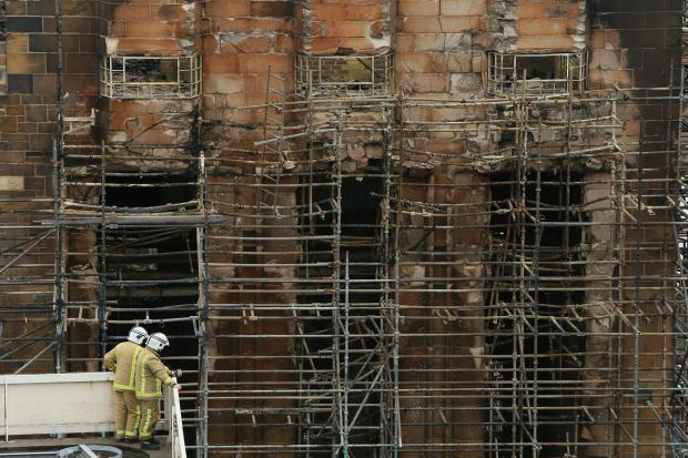 The National: Firefighters survey the damage to the Glasgow School of Art Mackintosh building. Picture: Colin Mearns.