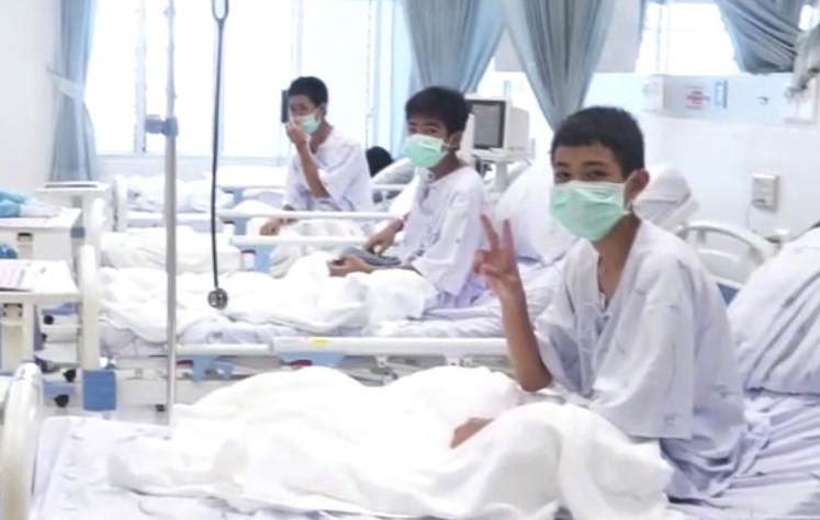 A video released by the Thailand Government Spokesman Bureau shows three of the boys recovering in their hospital beds