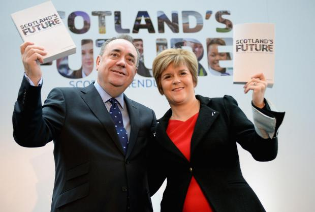The National: Then First Minister Alex Salmond and his deputy Nicola Sturgeon with the Scotlands Future White Paper.