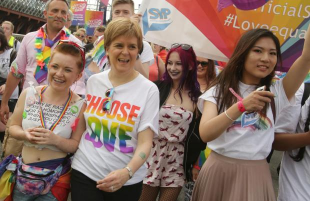 The National: First Minister of Scotland Nicola Sturgeon joins .people taking part in Pride Glasgow, Scotland's lesbian, gay, bisexual, transgender and intersex (LGBTI) pride event in Glasgow. PRESS ASSOCIATION Photo. Picture date: Saturday July 14, 2018. See PA st