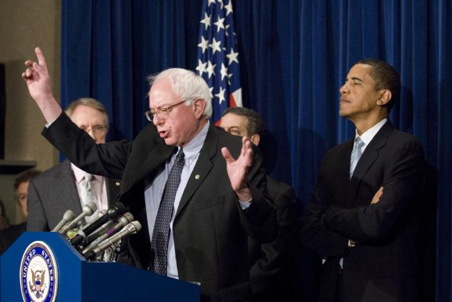 Bernie Sanders, flanked on his right by Barack Obama, when both were Senators in 2006