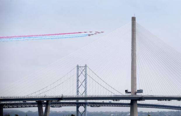 The National: The Red Arrows fly past during the official opening of the new bridge across the Firth of Forth
