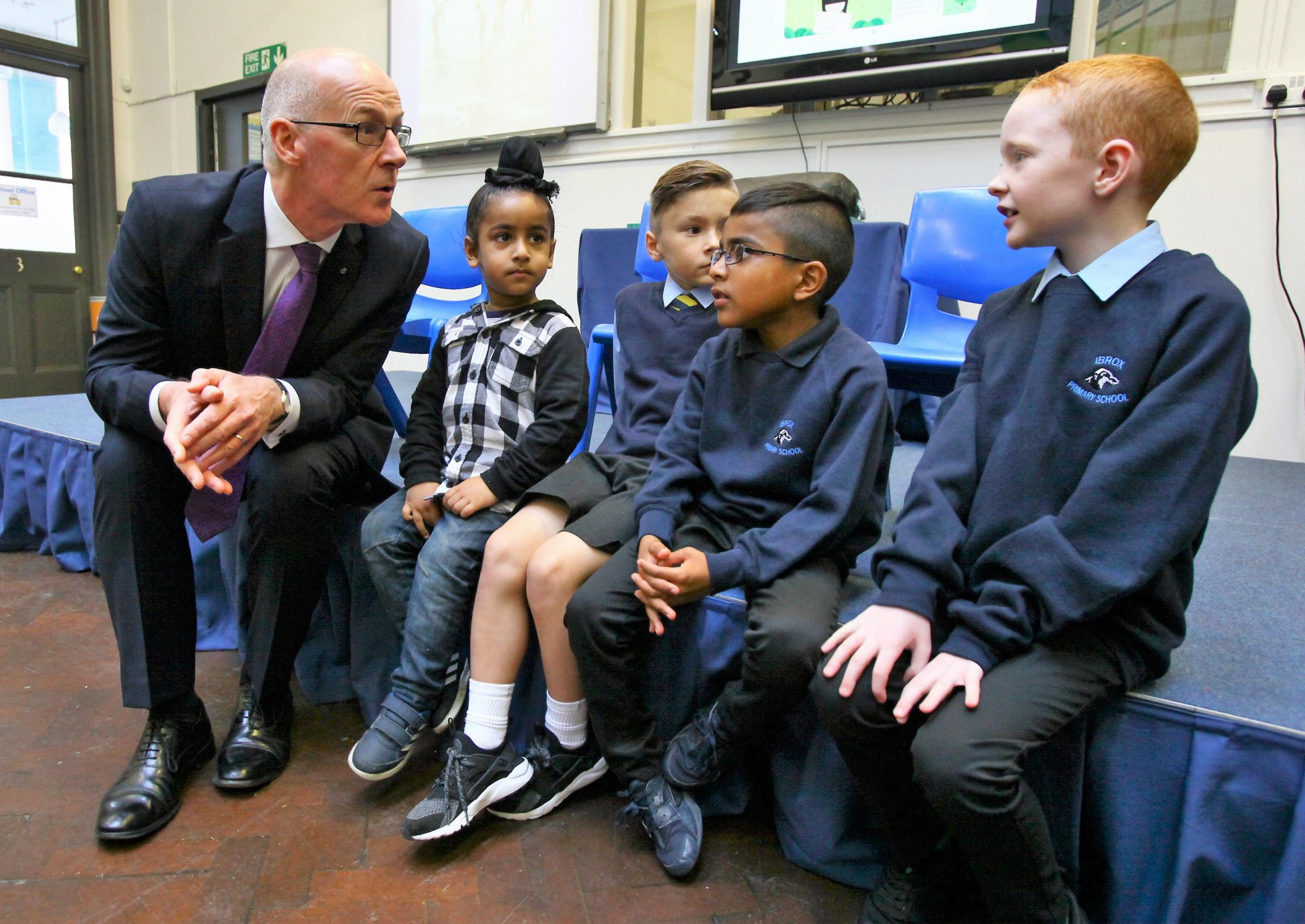 Education Secretary John Swinney has been criticised for refusing to scrap P1 assessments