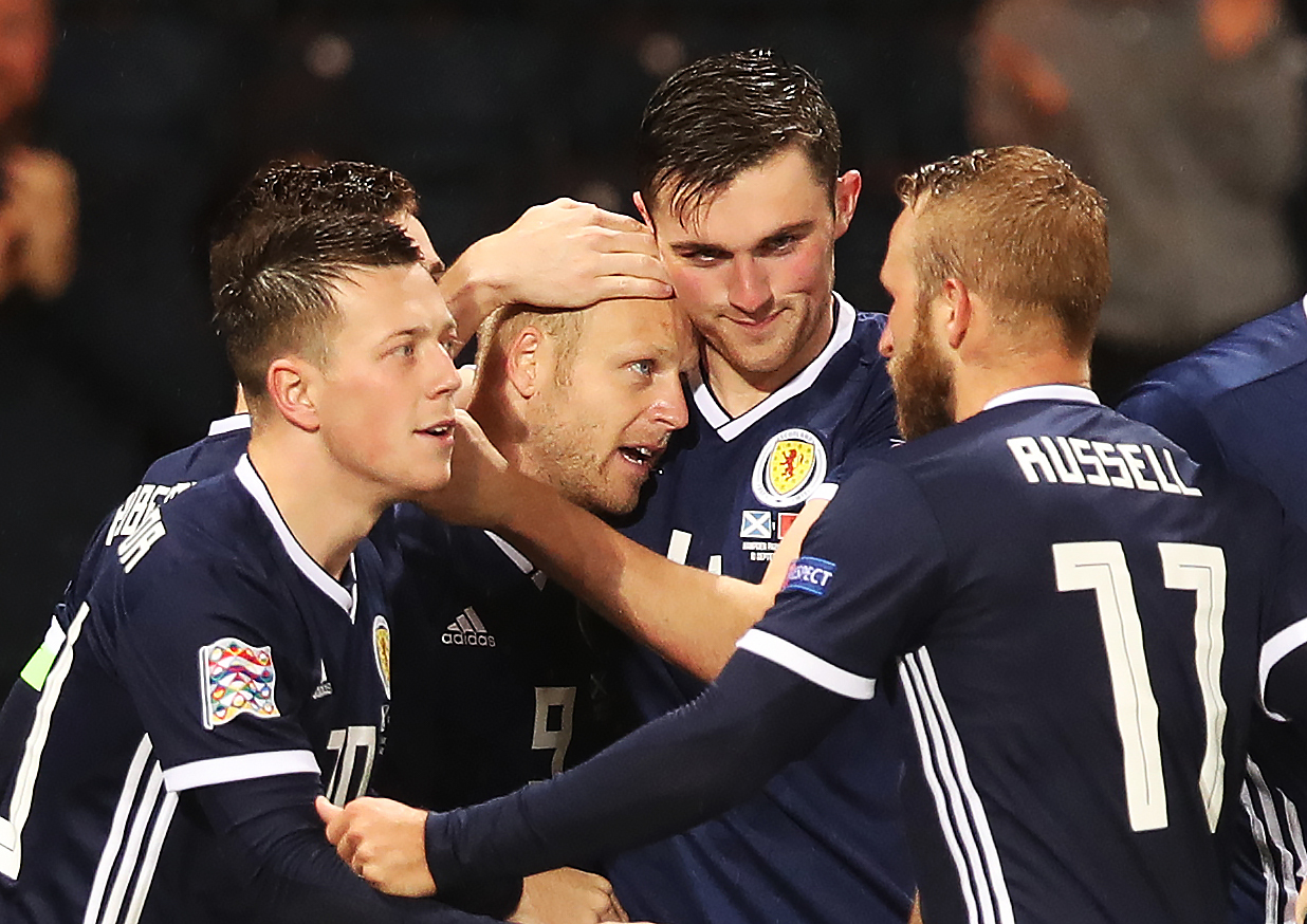 Steven Naismith is mobbed by his Scotland team mates after the opening goal against Albania.