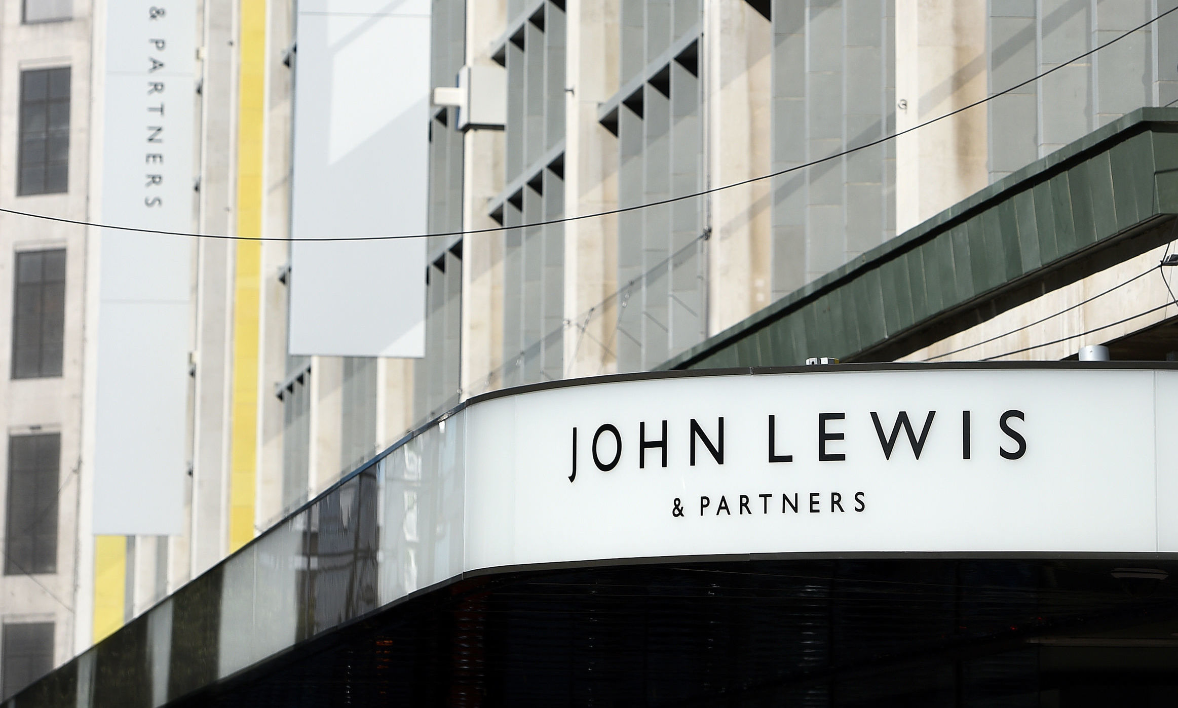 The John Lewis Partnership, which owns the department store chain and supermarket Waitrose, cited the impact of Brexit as one factor in a profit drop of 98.8%