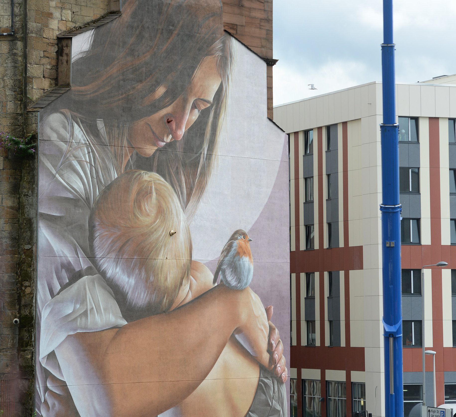 Smug's mural of Thaney and her son Mungo, at the corner of Glasgow's High Street, conveys a message about finding refuge in the city
