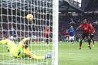 Jordan Pickford saves a Paul Pogba penalty, but the United midfielder scored from the rebound