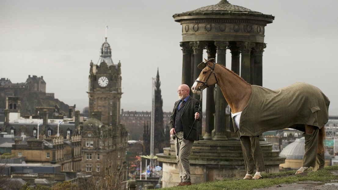 Kiltmaker Gordon Nicolson and Franklee atop Calton Hill, Edinburgh